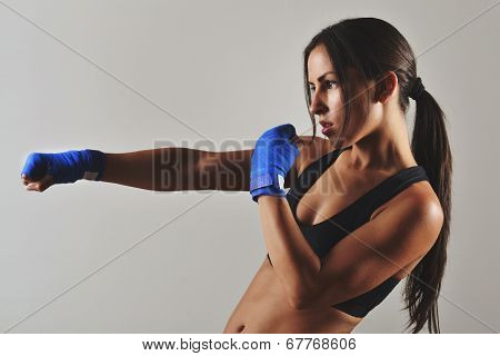 fitness woman with the blue boxing bandage