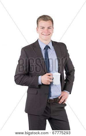 Young Man Is Holding A Cup Of Coffee