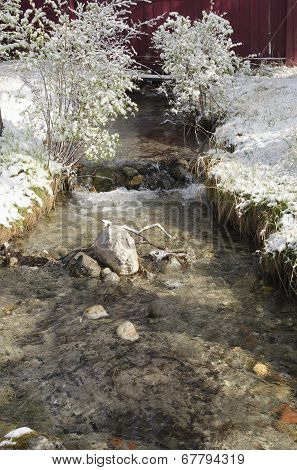 Mountain creek in the spring snow. The Arshan resort poster
