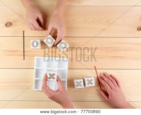 Game of Tic Tac Toe on wooden background poster