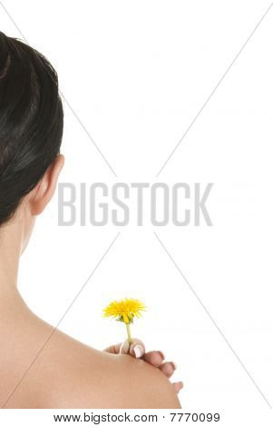 Woman Holds Ayellow Flower