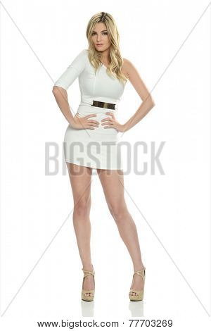 Young gorgeous blond with short dress isolated on a white background