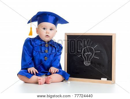 funny baby in academician clothes at chalkboard