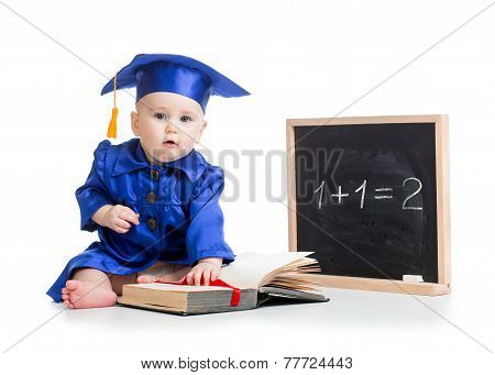 baby with open book in academician clothes at chalkboard