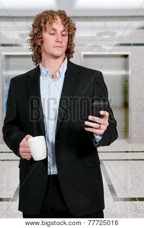 Man Texting With Coffee