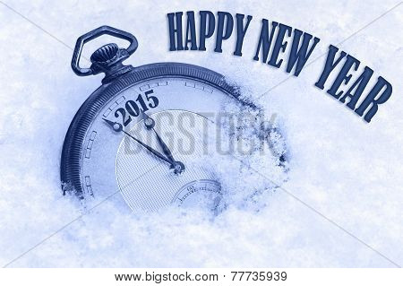 Pocket watch in snow Happy New Year 2015 greeting card