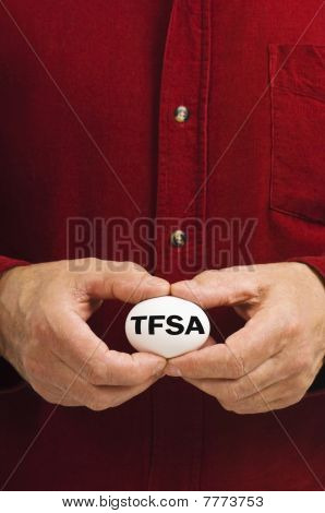 TFSA (Tax Free Savings Account) On White Nest Egg Held By Man