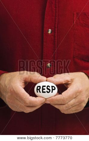 RESP Written On White Nest Egg Held By Man