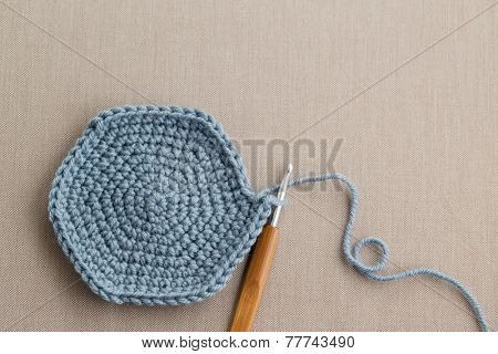 Blue wool with crochet hook