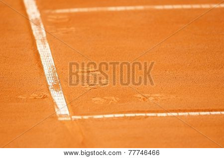 Footprints On A Tennis Clay Court