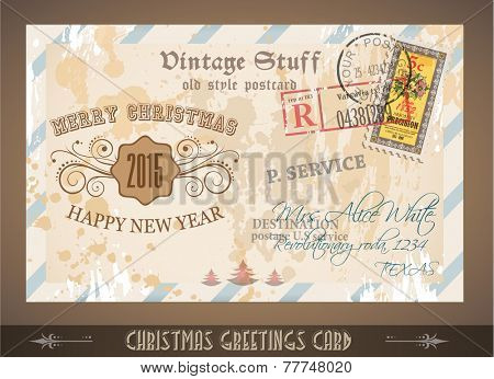 Vintage Postcard for Christmas greetings cards with postage stamps and festive text with fake address. Retro design with distressed old look.