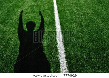 Shadow Of American Football Referee Signaling Touchdown