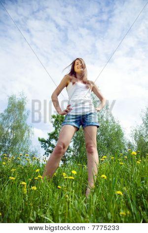 Teen Standing  In Dandelion Meadow