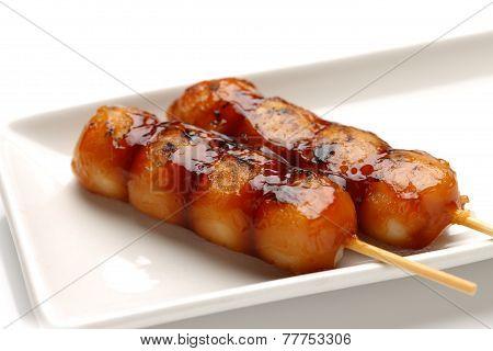 studio shot of Japanese traditional dessert MTARASHI DANGO dumpling poster