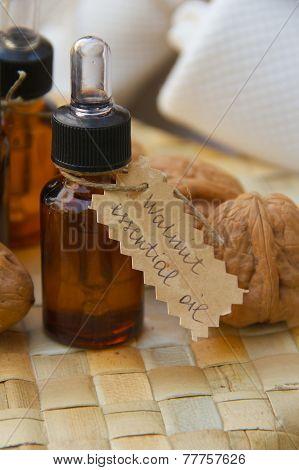 Walnut essential oil in a dropper bottle.
