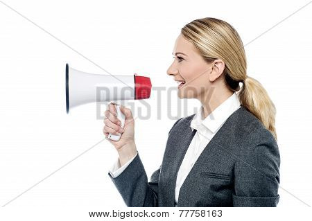 Business Woman Proclaiming Into Megaphone