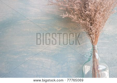 Glass Bottle Of Dried Flower