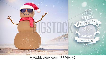 Snow falling against festive sandman on the beach