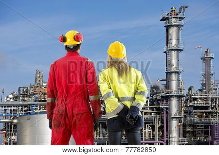 Two petrochemical engineers looking at a new cracking facility for hydrocarbon products used in polyurethane compounds