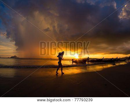 Woman on the beach at sunset on Ao Nanag beach in Krabi Thailand