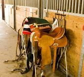 General view of saddles and paraphenalia at stables. poster