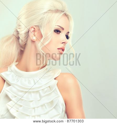 Beautiful blonde woman with retro hairstyle and fluffy fleece tail