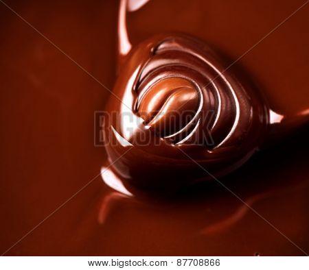 Chocolate praline. Chocolates background. Chocolate. Liquid chocolate. dark and milk chocolate. Sweets