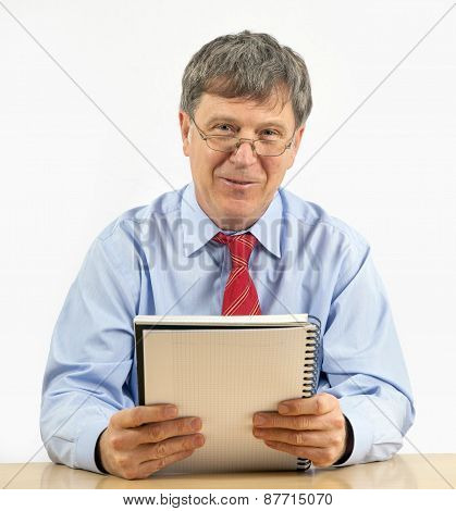 Business Man Reads In A Diary
