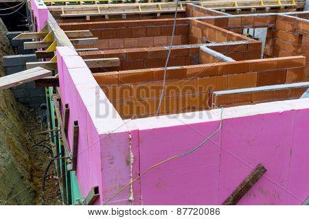 a detached house is built in solid construction with brick. thermal insulation is applied.