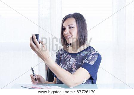 Woman Checking A Reader .