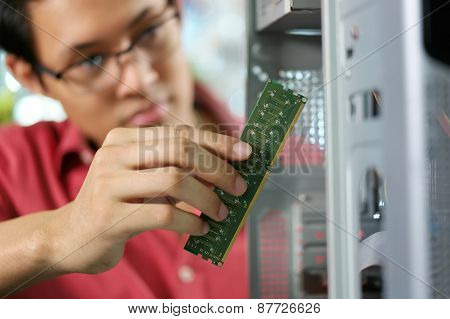 Portrait Of Chinese Man Reparing Pc In Computer Shop