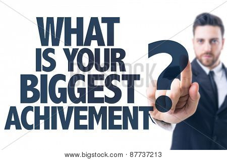 Business man pointing the text: What Is Your Biggest Achievement?