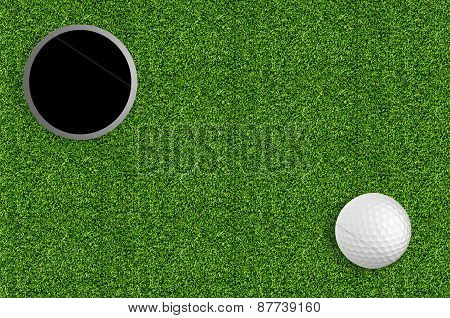 Golf Ball And Hole On The Green Grass Of The Golf Course