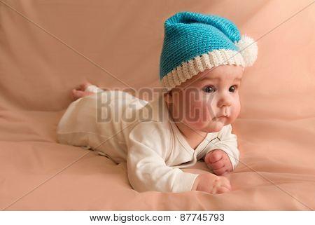 Curious Child In Blue Cap