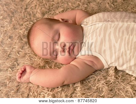 Cute Baby Sleeping On Carpet