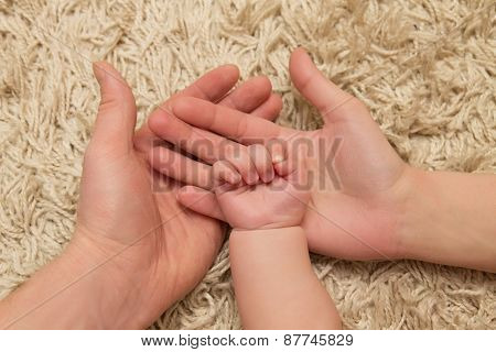 Parents Hold The Child's Hand