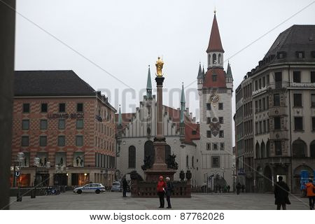 MUNICH, GERMANY - MARCH 4, 2012: People in front of the Altes Rathaus (Old Town Hall) in Marienplatz Square in Munich, Bavaria, Germany.