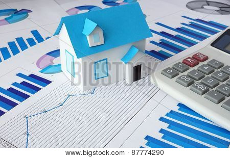 Model  house for sale and graphs. Real estate