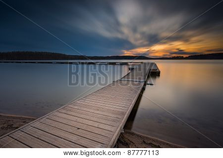 Beautiful Long Exposure Lake With Jetty At Sunset.