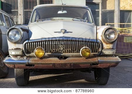 Moscow, Russia, April 11, 2015: Vintage Old Rusty Forsaken Weathered Once White Gaz-m-21