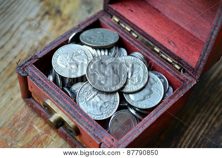 Little treasure chest with american quarter of a dollar cents
