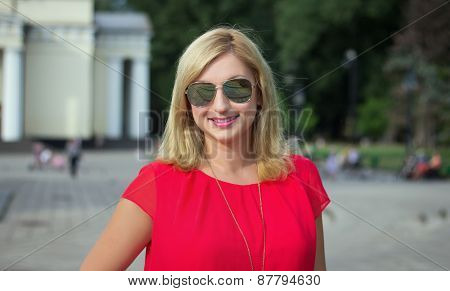 Happy Blonde Woman In Sunglasses