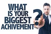 Business man pointing the text: What Is Your Biggest Achievement? poster