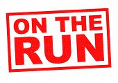 ON THE RUN red Rubber Stamp over a white background. poster