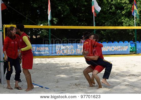 MOSCOW, RUSSIA - JULY 17, 2015: Team Spain celebrates the victory in the match of ITF Beach Tennis World Team Championship against Venezuela. Spain won 2-1