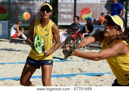 MOSCOW, RUSSIA - JULY 17, 2015: Samantha Barijan (in front) and Joana Cortez of Brazil in the quarterfinal match of the Beach Tennis World Team Championship against France. Brazil won the match 2-1