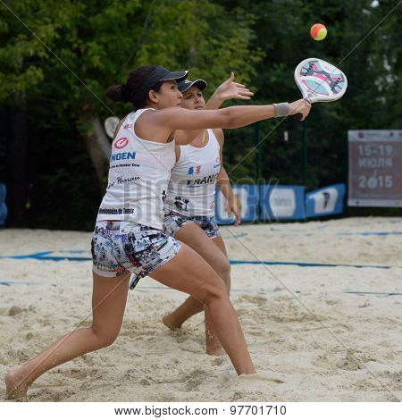 MOSCOW, RUSSIA - JULY 17, 2015: Marie-Eve Hoarau (left) and Mathilde Hoarau of France in the match of ITF Beach Tennis World Team Championship against Japan. France won the match 3-0