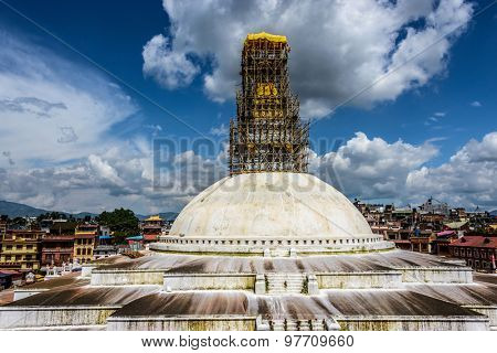 KATHMANDU, NEPAL - 24 JULY, 2015: Bamboo scaffolding is set up on the top of Boudhanath stupa in order to repair the damages caused by the Nepal earthquake of April 25, 2015.