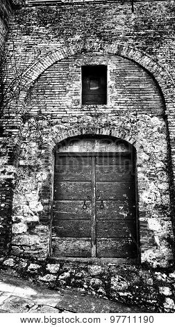 Wooden Door In Tuscany, Italy In Black And White