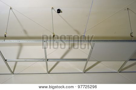 construction of the structure of a suspended ceiling with plasterboard poster